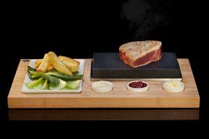 Le Steak grésillant situé de SteakStones, la maison de la pierre chaude de cuisson