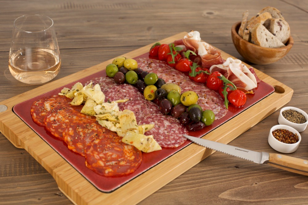Antipasti Platter Served on Lava Stone. Featuring SteakStones Glazed Lava Platter - the best Hot Stone Cooking Products Guaranteed